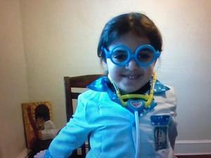 girl wearing doctor costume