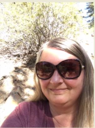 Headshot of Tracyee Becker wearing big sunglasses.