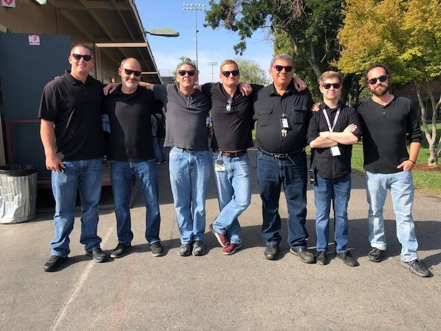 "CCA teachers wearing black shirts, blue jeans, and pink sun glasses for ""Twin Day."""