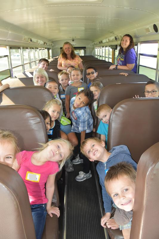 Kindergarten students load the bus for their first ride.