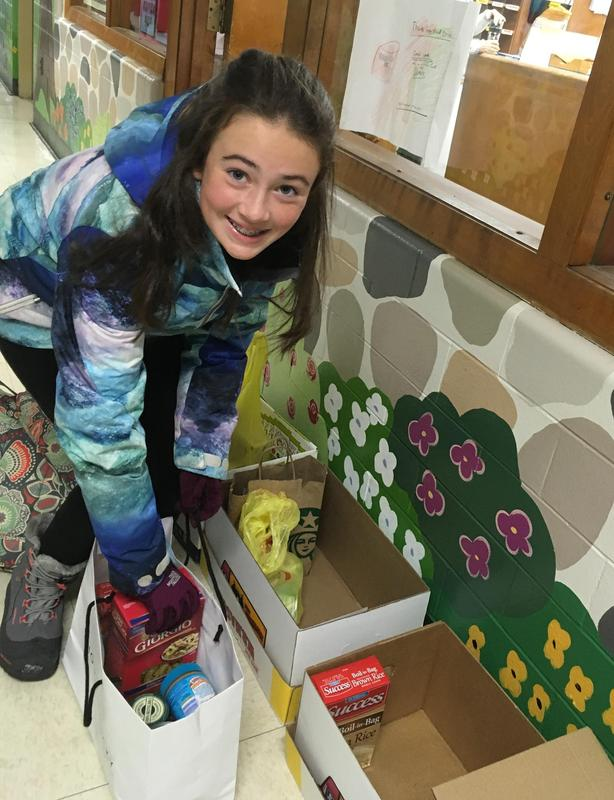 The Early Act Club of Jefferson School coordinated a food drive to help those less fortunate. Pictured here is one member of the club with donations.