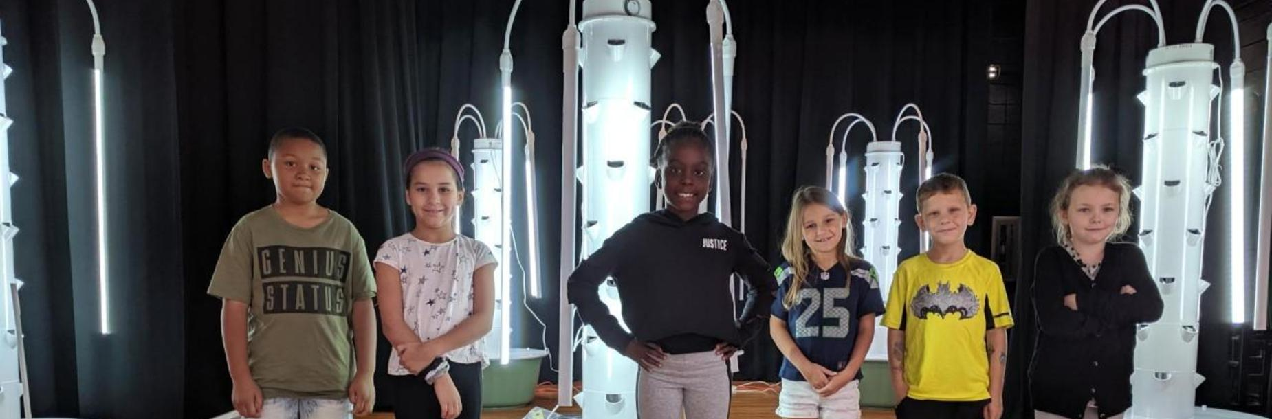 2nd grade students with Hydroponics towers.