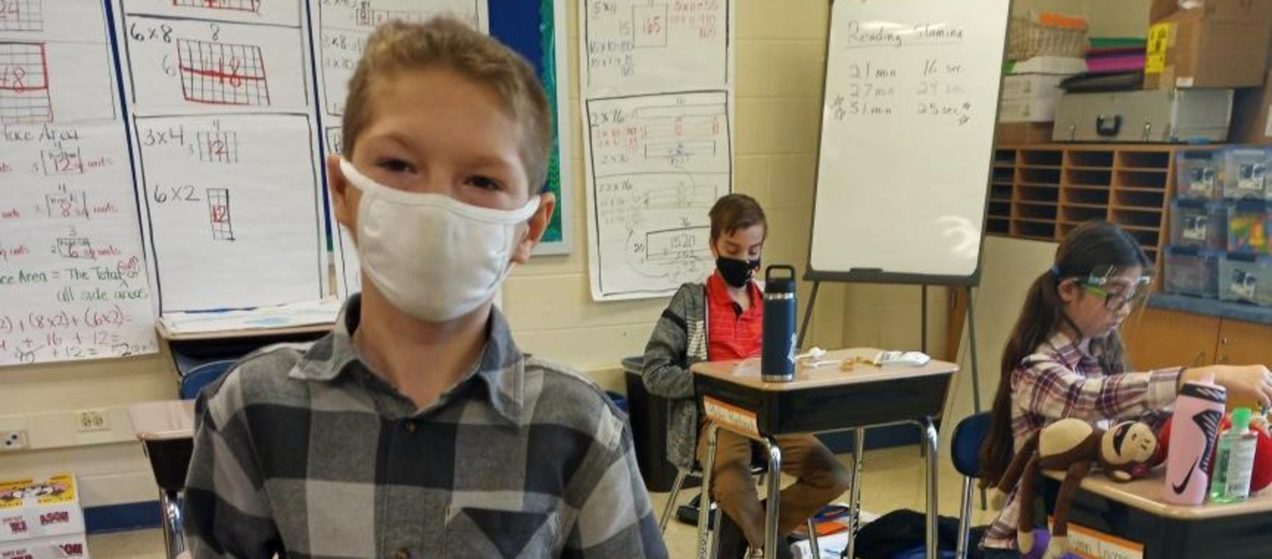 students wearing masks working on projects