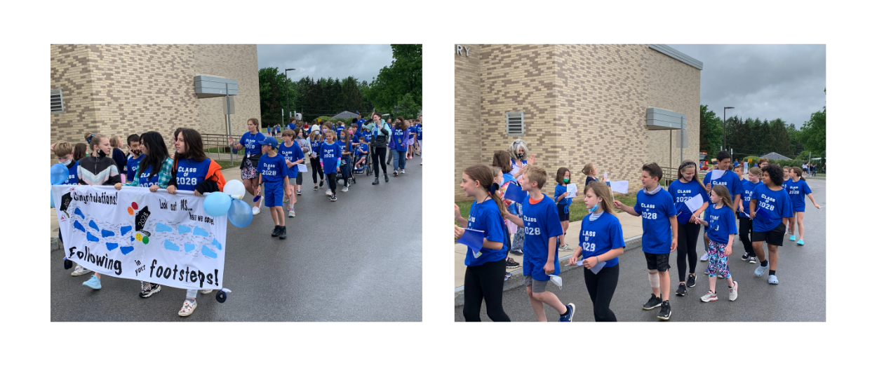5th grade students in class of 2028 tshirts walking behind seniors