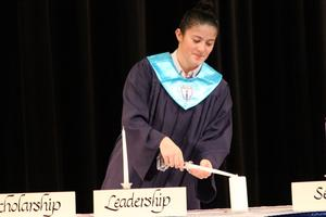 Current National Honor Society member begins by lighting the scholarship pillar candle.