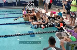 students ready for regatta race in pool