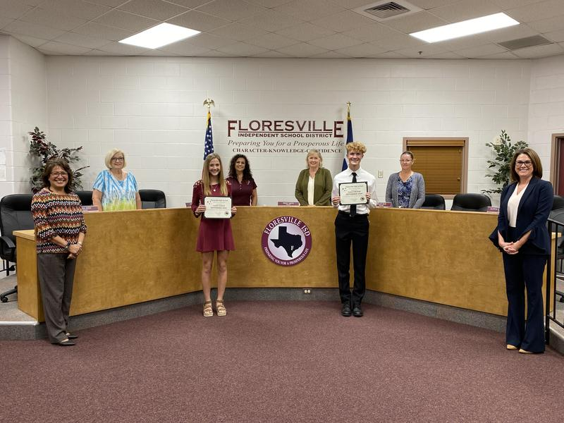 October Students of the Month with Board of Trustees standing social distanced