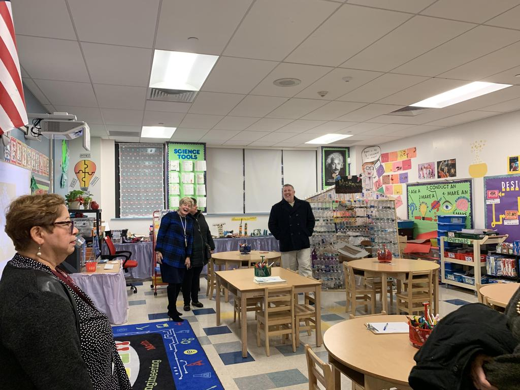 Principal Tamargo with Asst. Supt. Bennetti & Perez with Parent Liaison inside science room