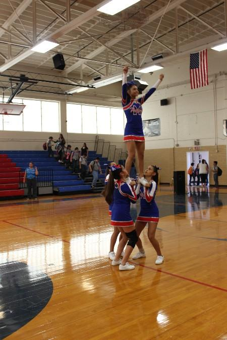 MJHS Cheerleaders performing a stunt after a pep rally.