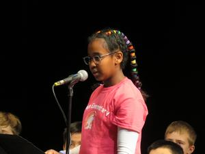 Exley Roon takes a turn in front of the judges waiting for her word to spell.