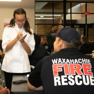 teen waitress taking order of fireman