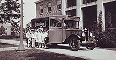 Image of NYI school kids loading up a 1920s school bus