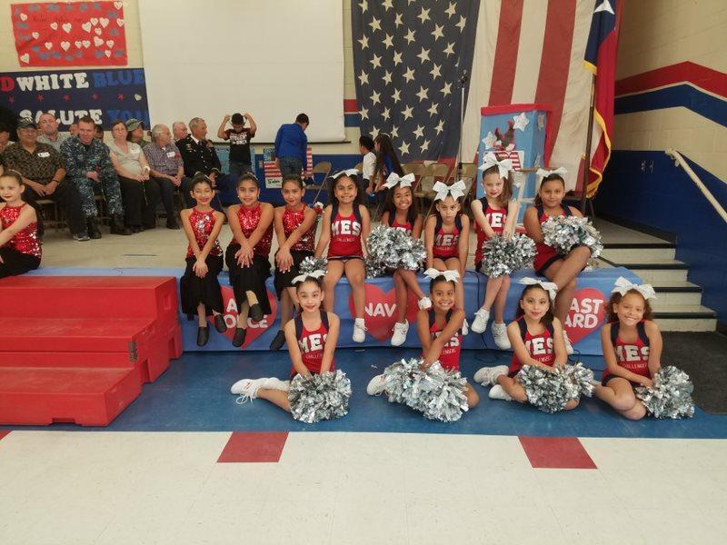 cheerleaders posing on stage.