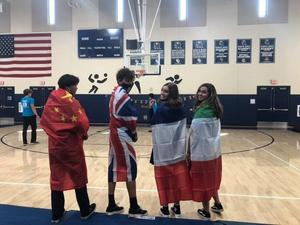 Students with masks and flags