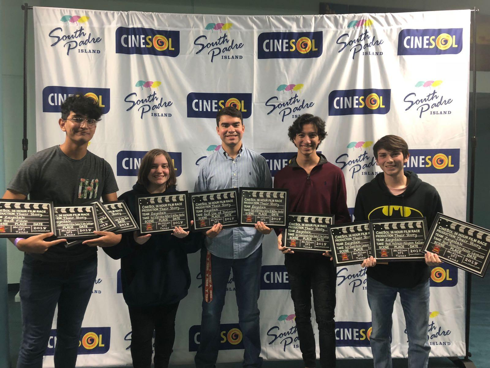 students holding CineSol award plaques
