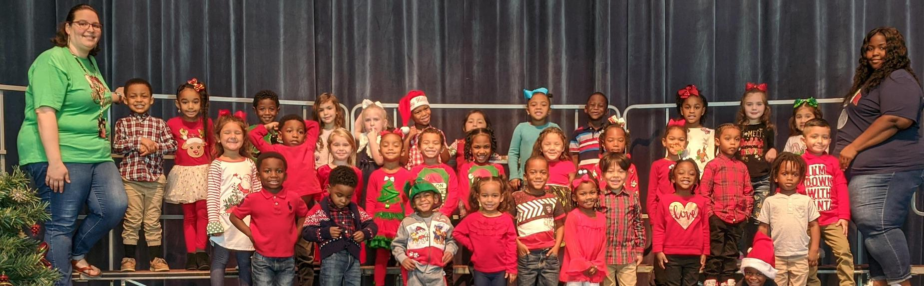 Children acknowledged with Positive Behavior Sing Christmas Songs at the Beaumont Event Center
