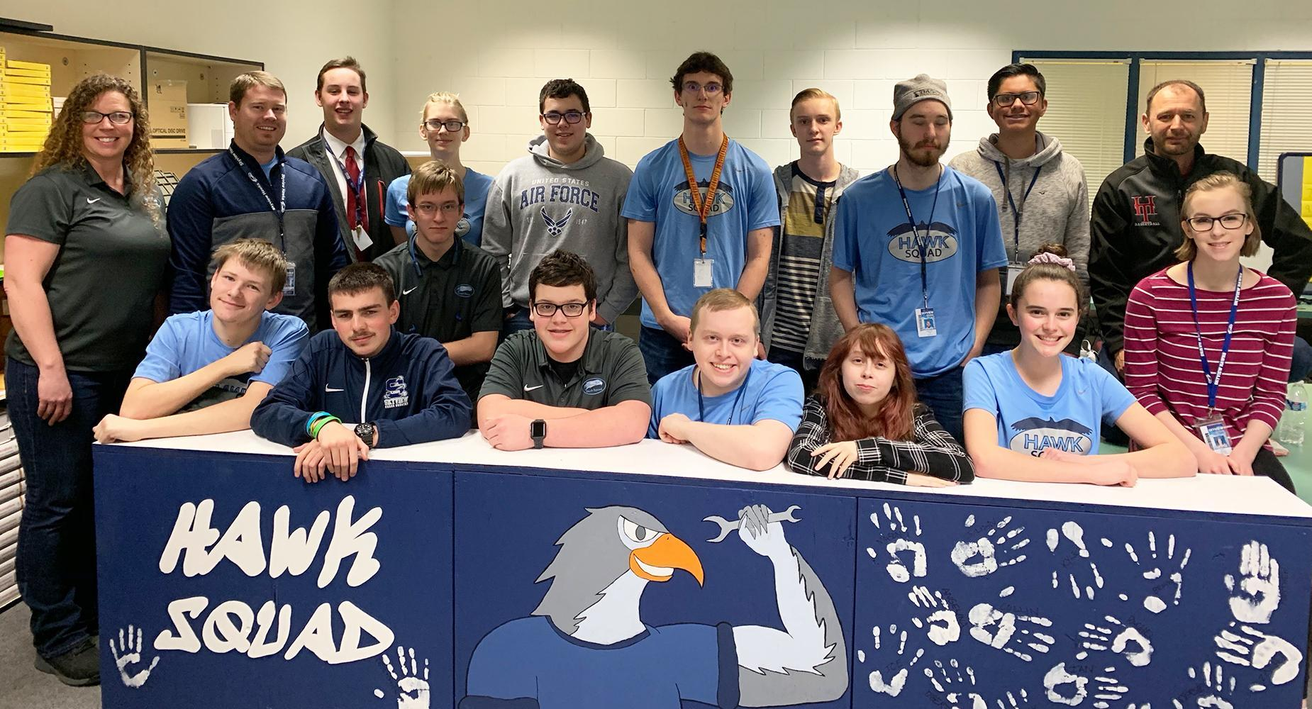 Photo of Hawk Squad students at long table.