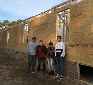 Lexington Two students pose earlier this year in front of the home as it was being built on Tree Street