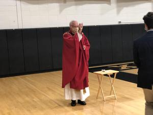 Father Frank Gilbert celebrating communion at Opening of School Mass 2020.