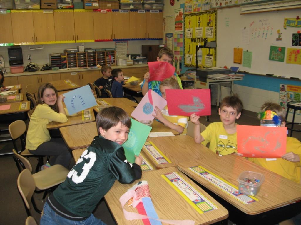 students create art at desks