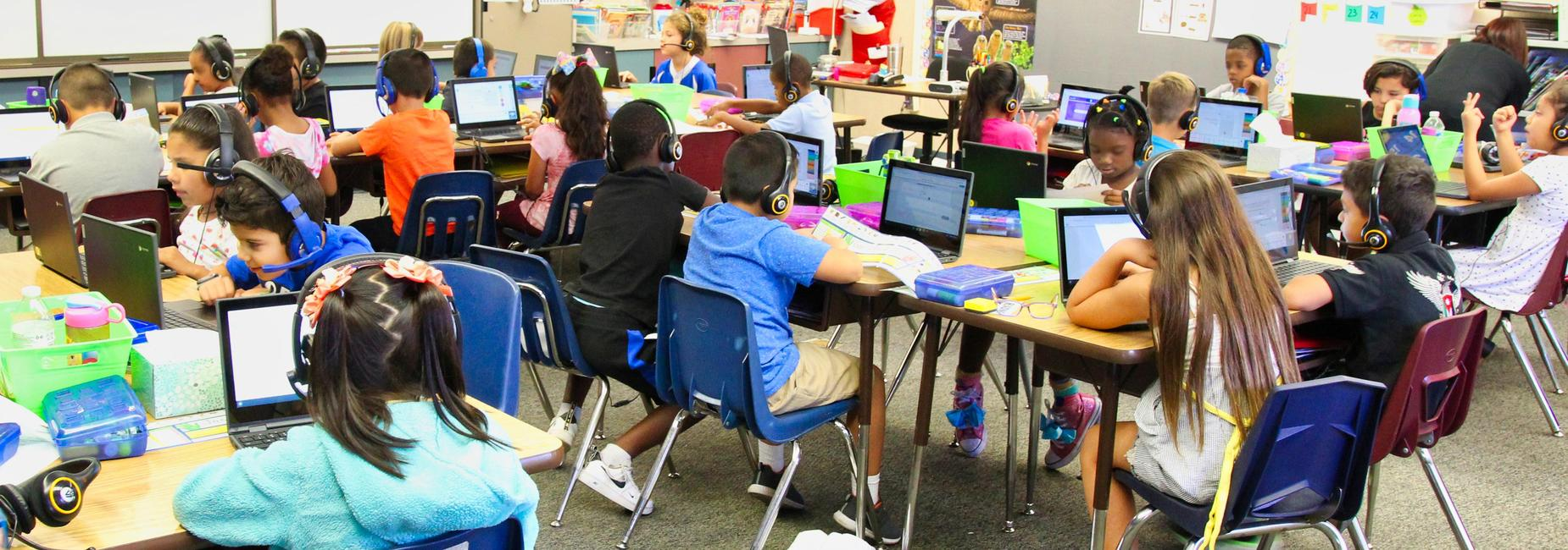 Students learning on computers