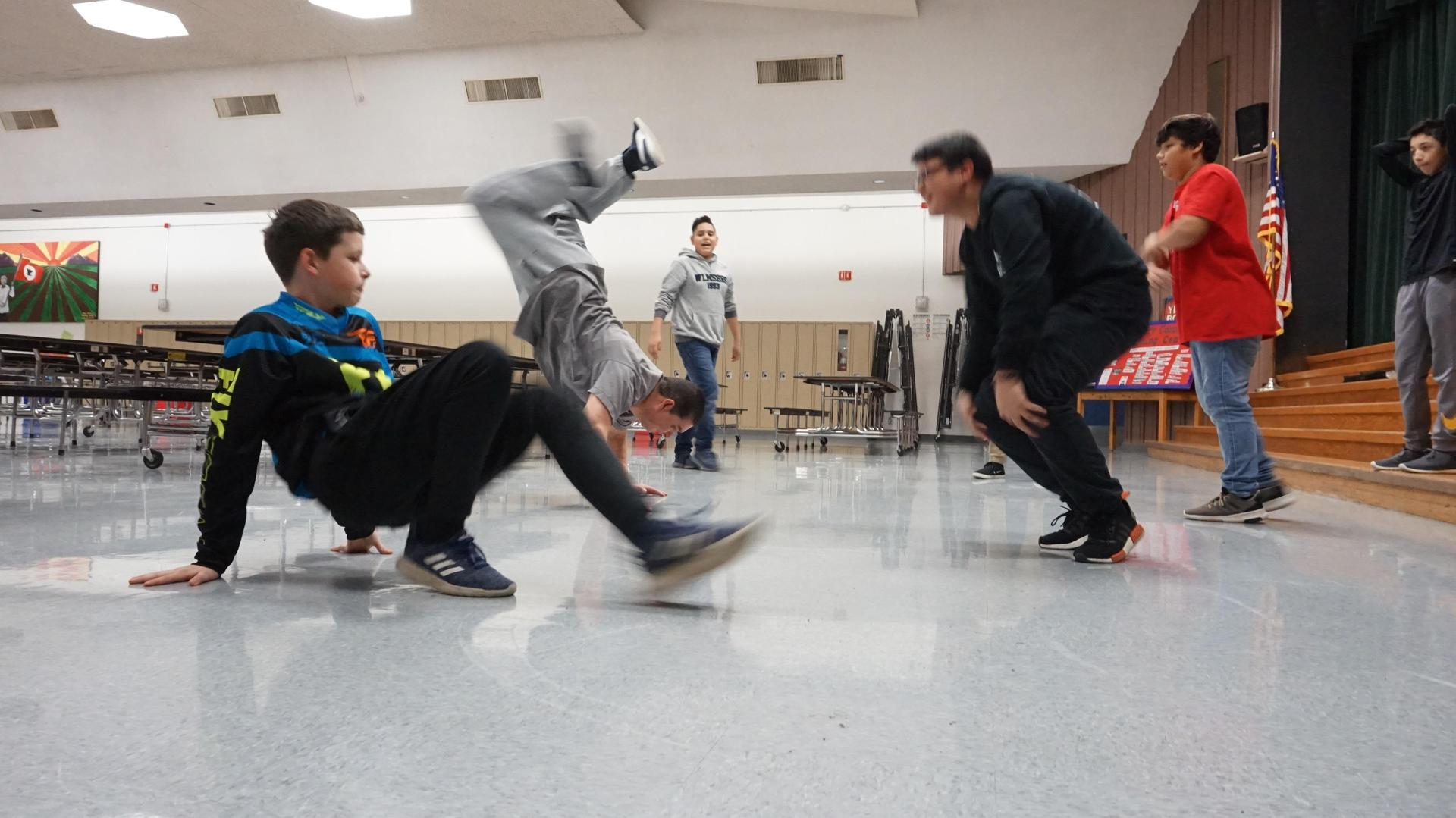 Several students practicing their dancing