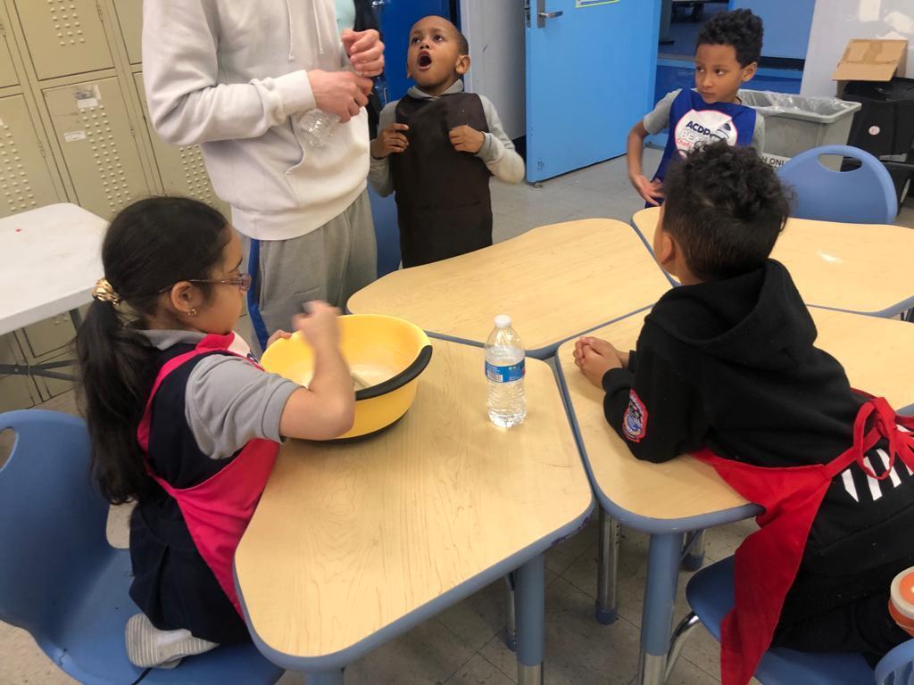 children mixing ingredients
