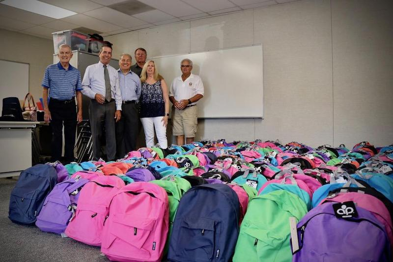 Rotary members and Magnolia staff members delivered the backpacks to the District on Thursday, August 28th