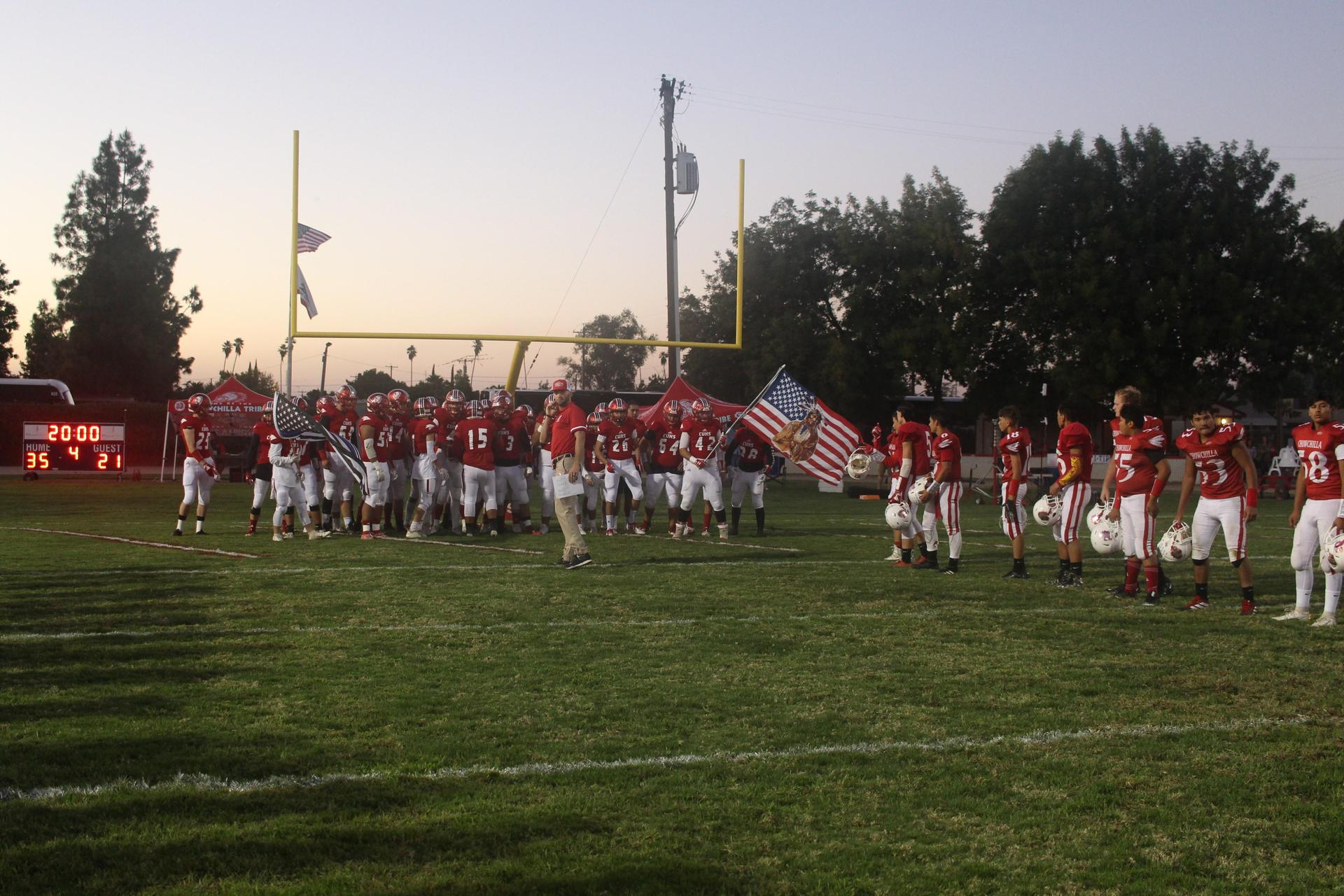 football team entering the stadium
