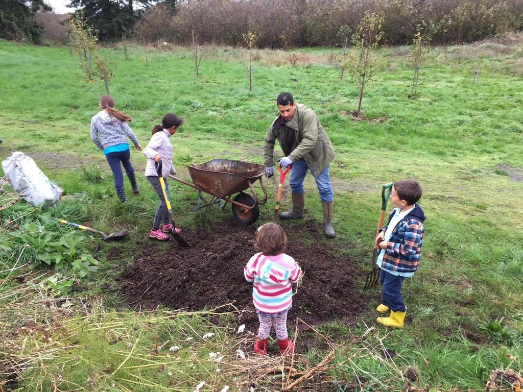 Students and parent helping at garden clean-up day