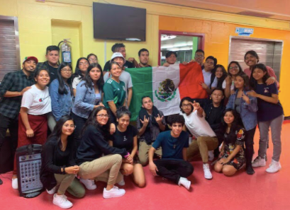 group of students around Mexican flag