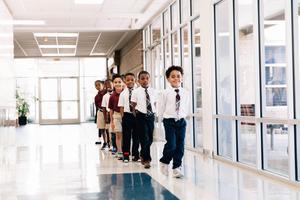 Students walking in hallway.