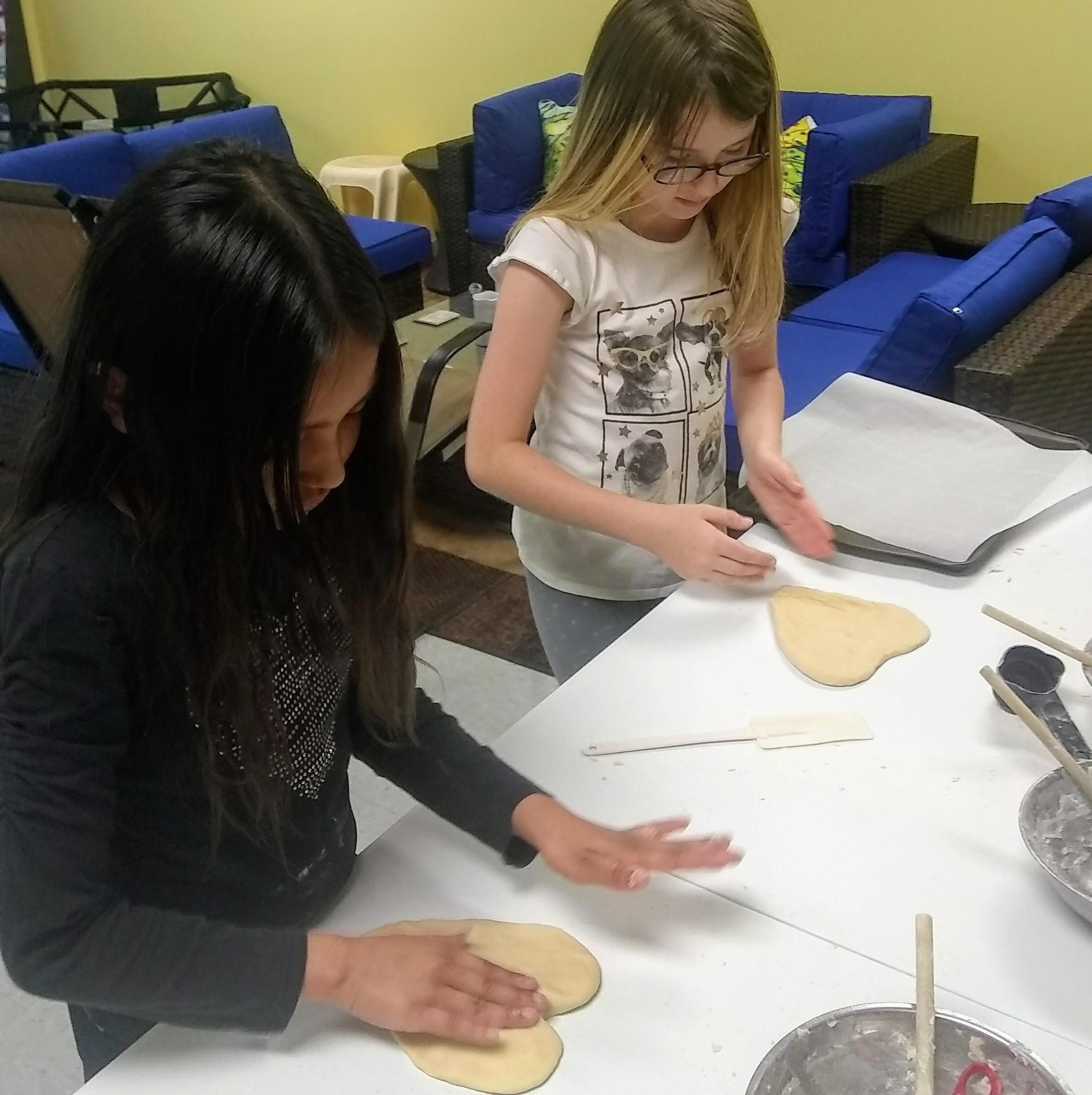 children shaping dough