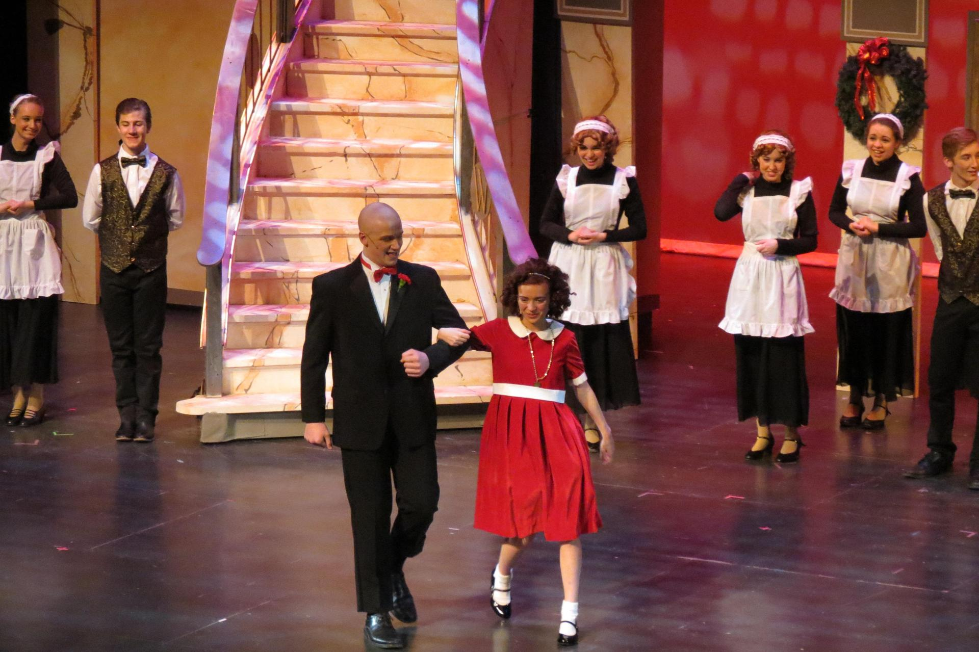 Warbucks and Annie in a scene from the end of the musical.