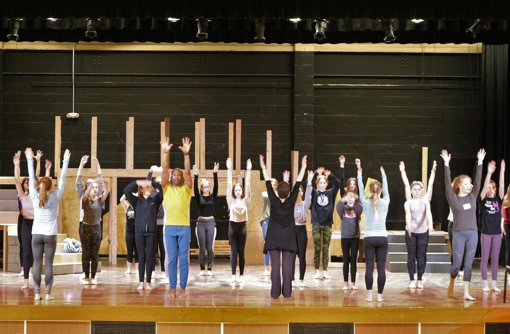 Photo of Edison students taking part in a master dance class conducted by the Carolyn Dorfman Dance troupe.