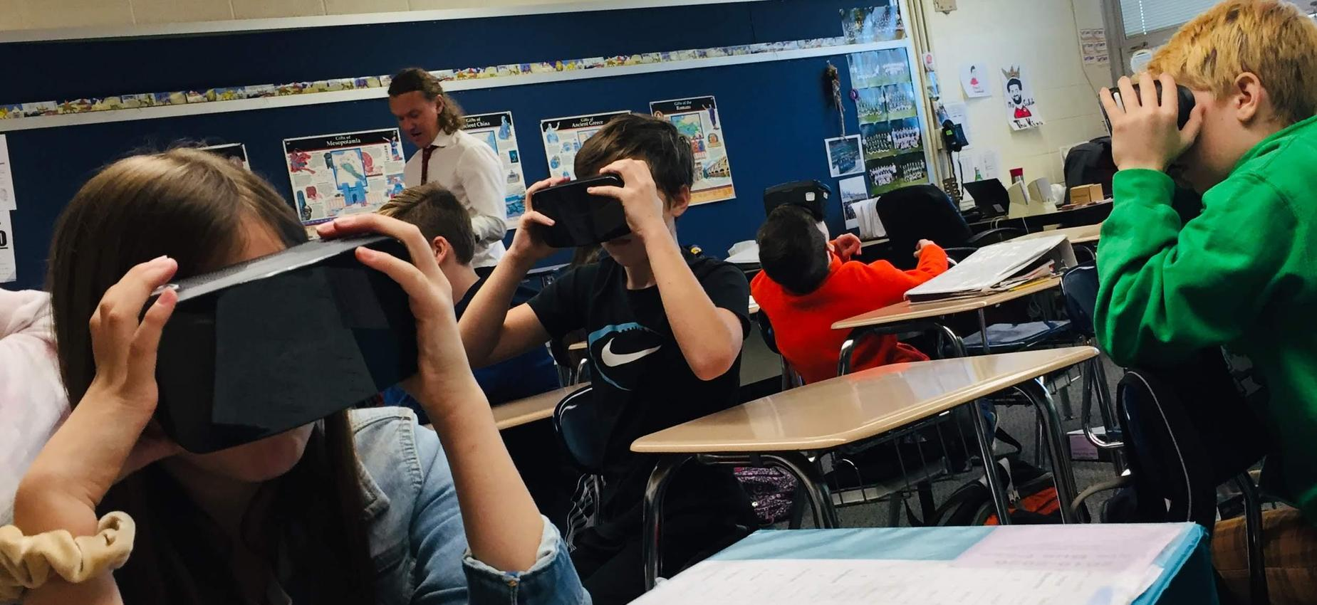 students using VR goggles