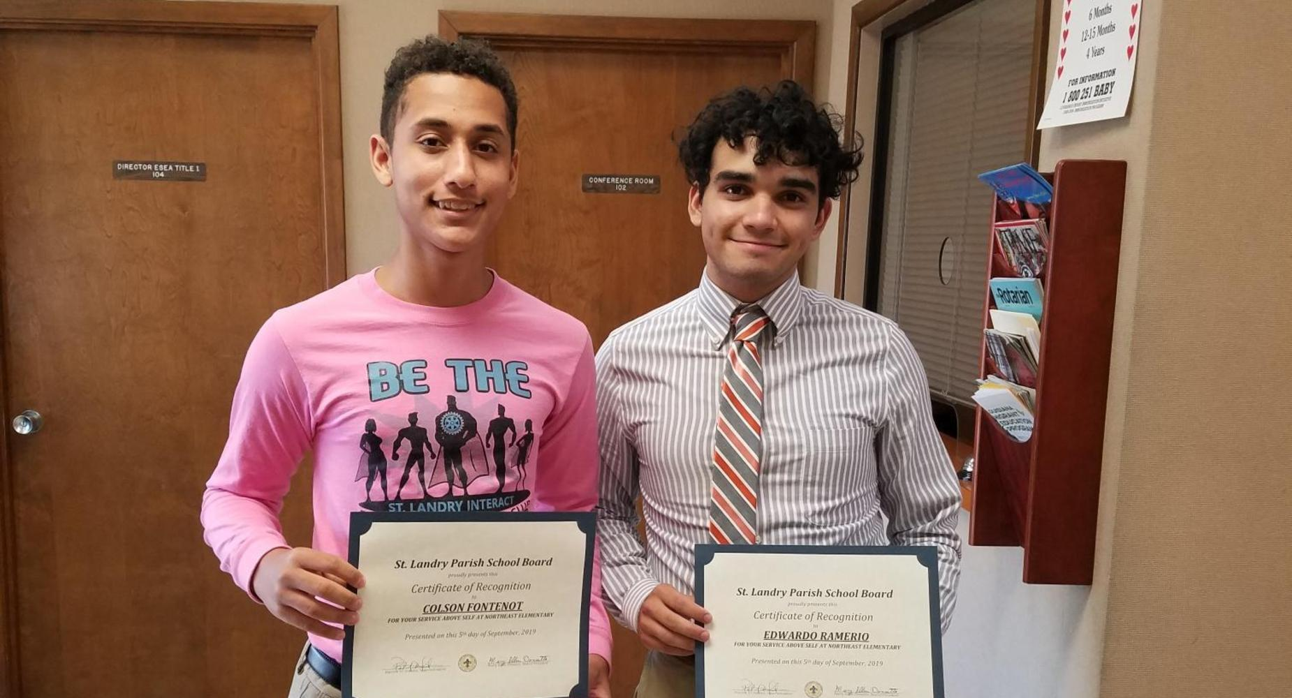 Colson Fontenot and Eddie Ramirez are recognized at the school board for