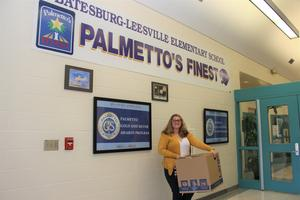 Pictured is B-L High School alumna Helena Burton as she drops off items from the Panther Pride School Supply Drive to B-L Elementary School.