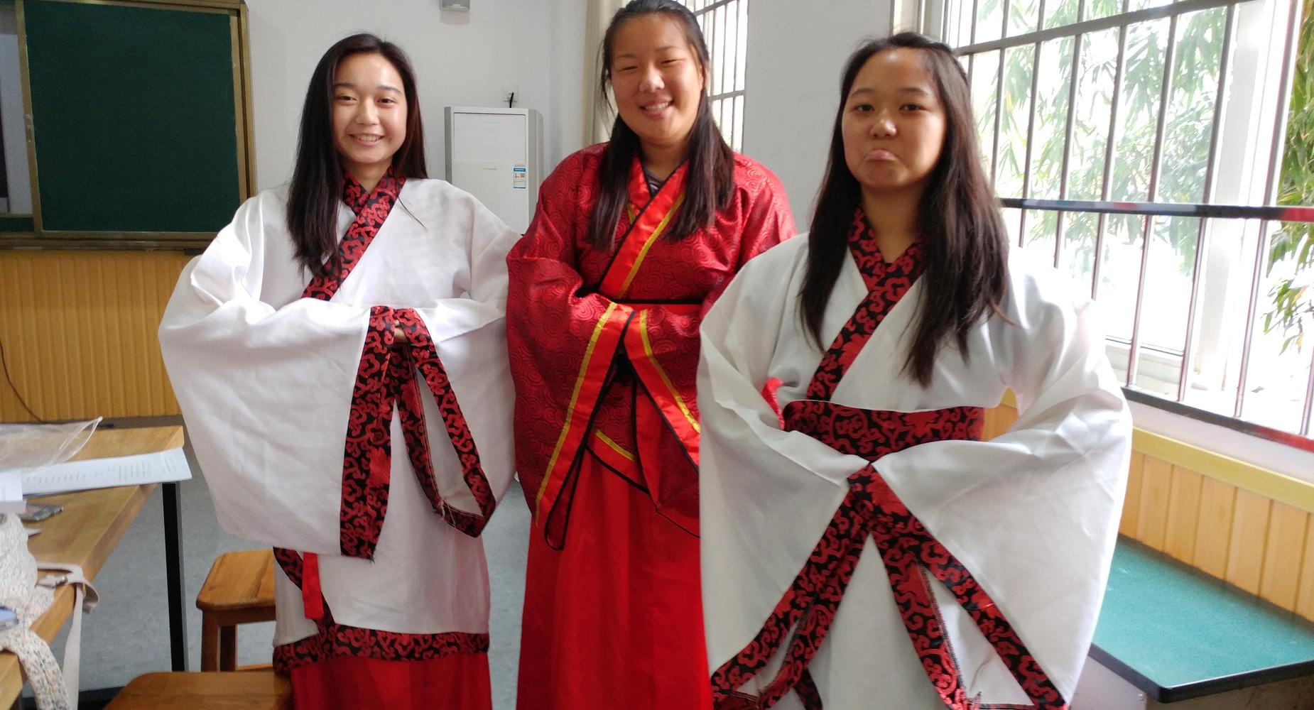 Three students in China wearing kimonos
