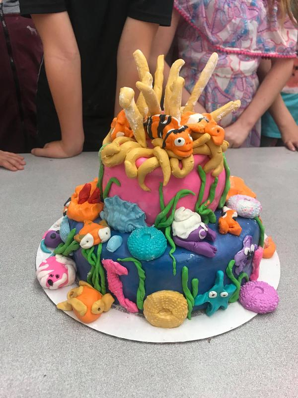 An under water theme cake has lots of coral and fish.