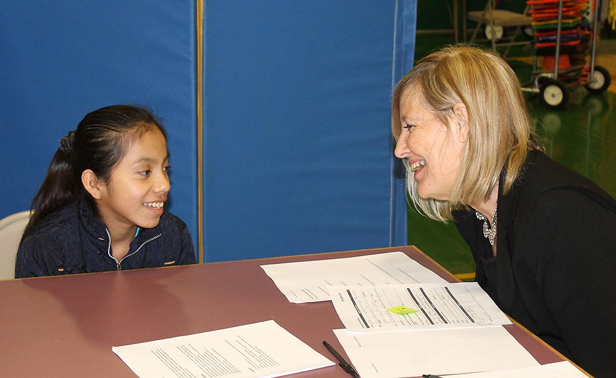 Cheatham County Director of Schools Dr. Cathy Beck visits with an East Cheatham Elementary School student.