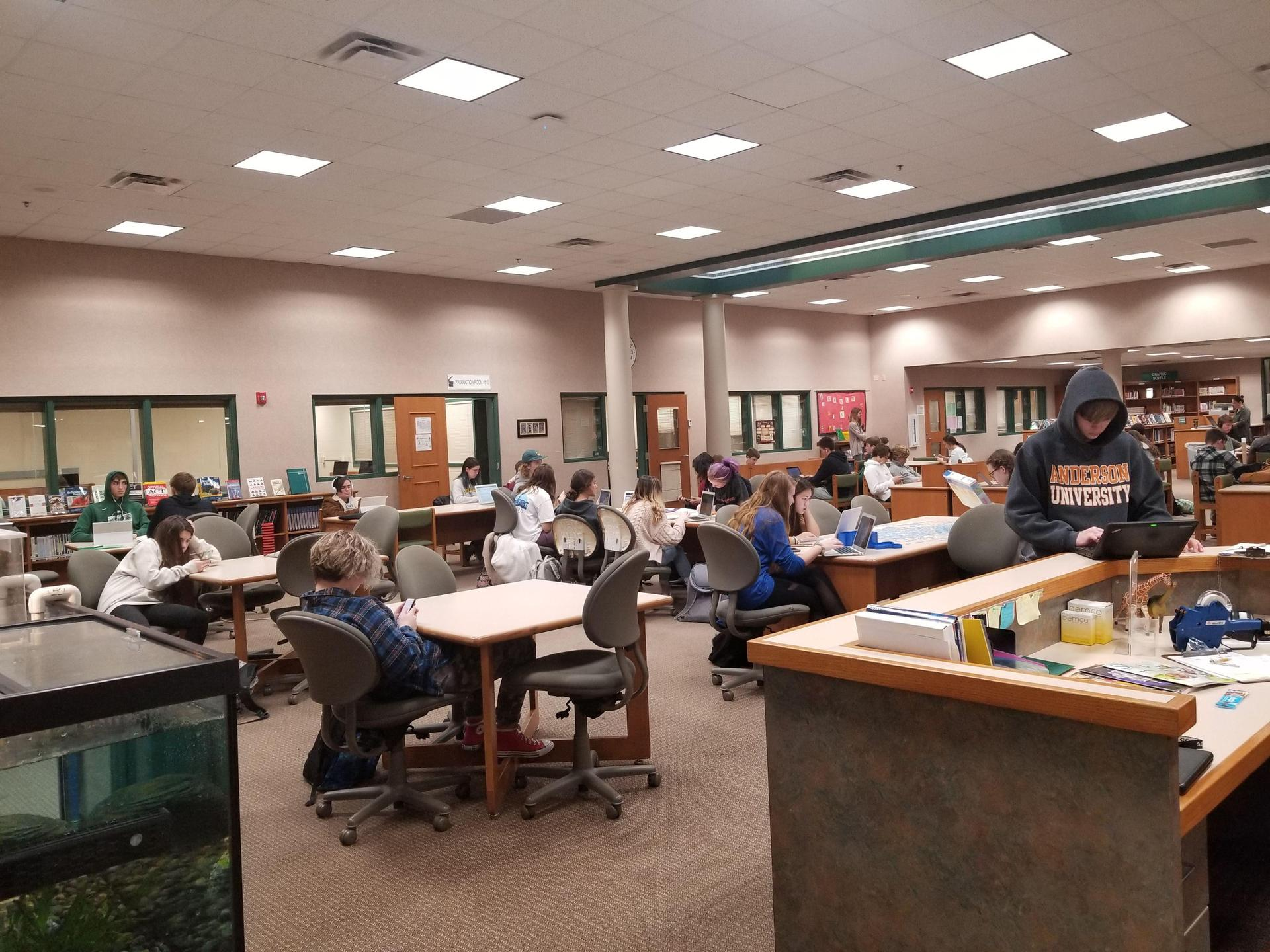 Picture of the High School Media Center with Many Students Working at Various Tables