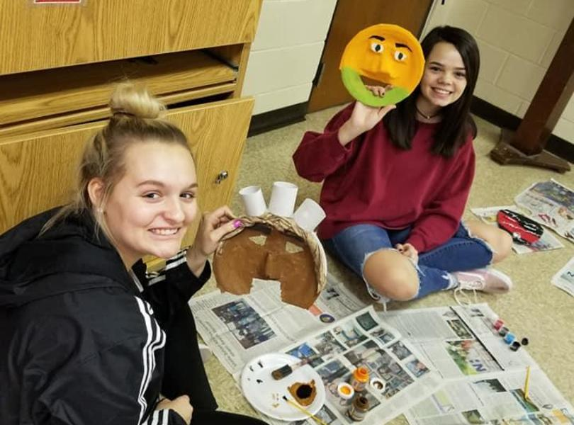 Theater students making masks