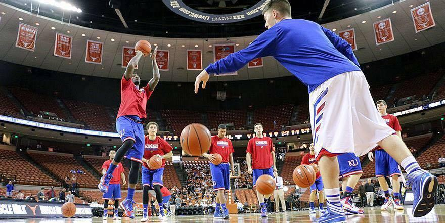 Warming up as a student manager at KU for a game at Texas