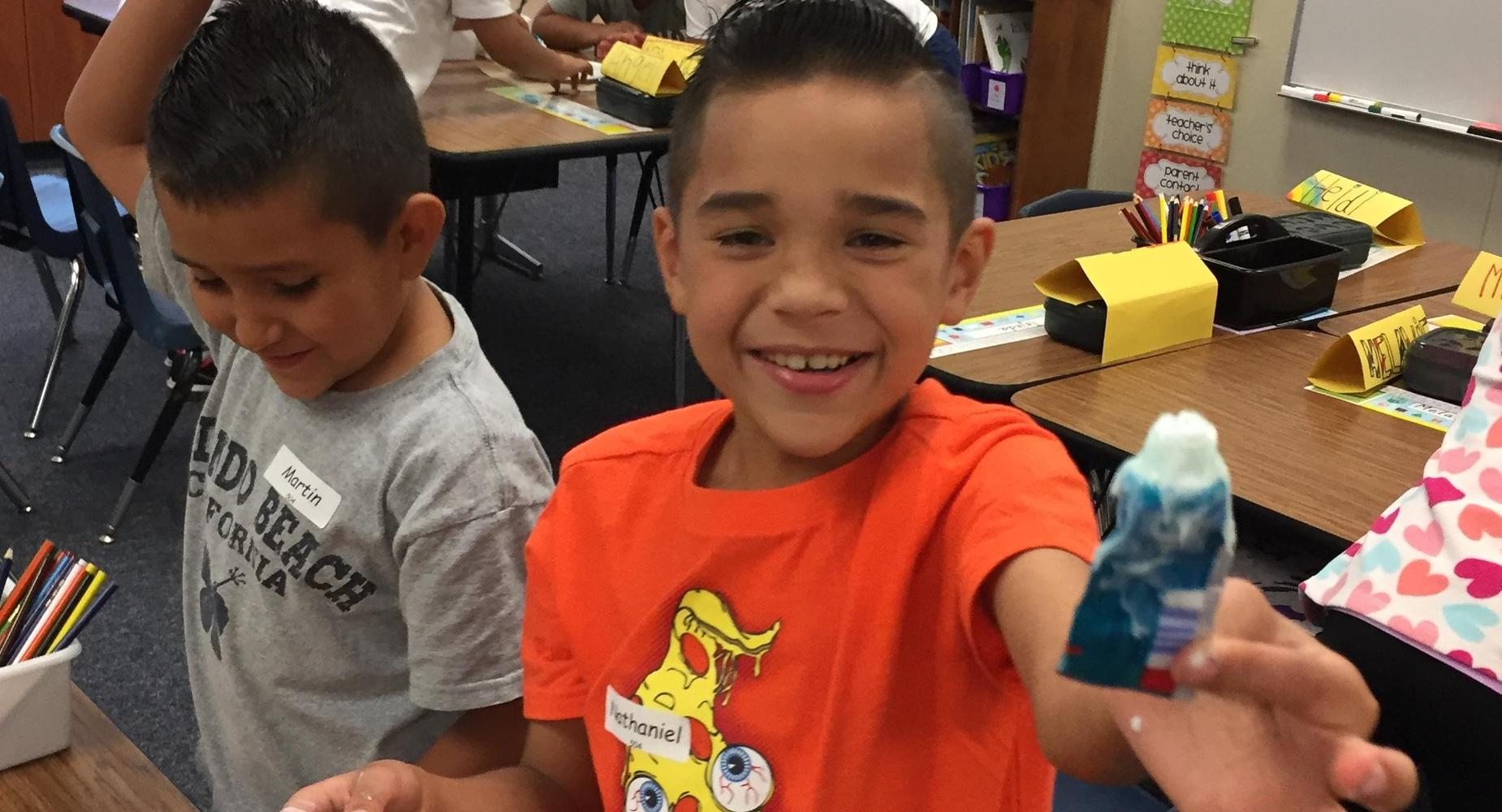Student in Mrs. Houser's 2nd grade class holding toothpaste for an activity.