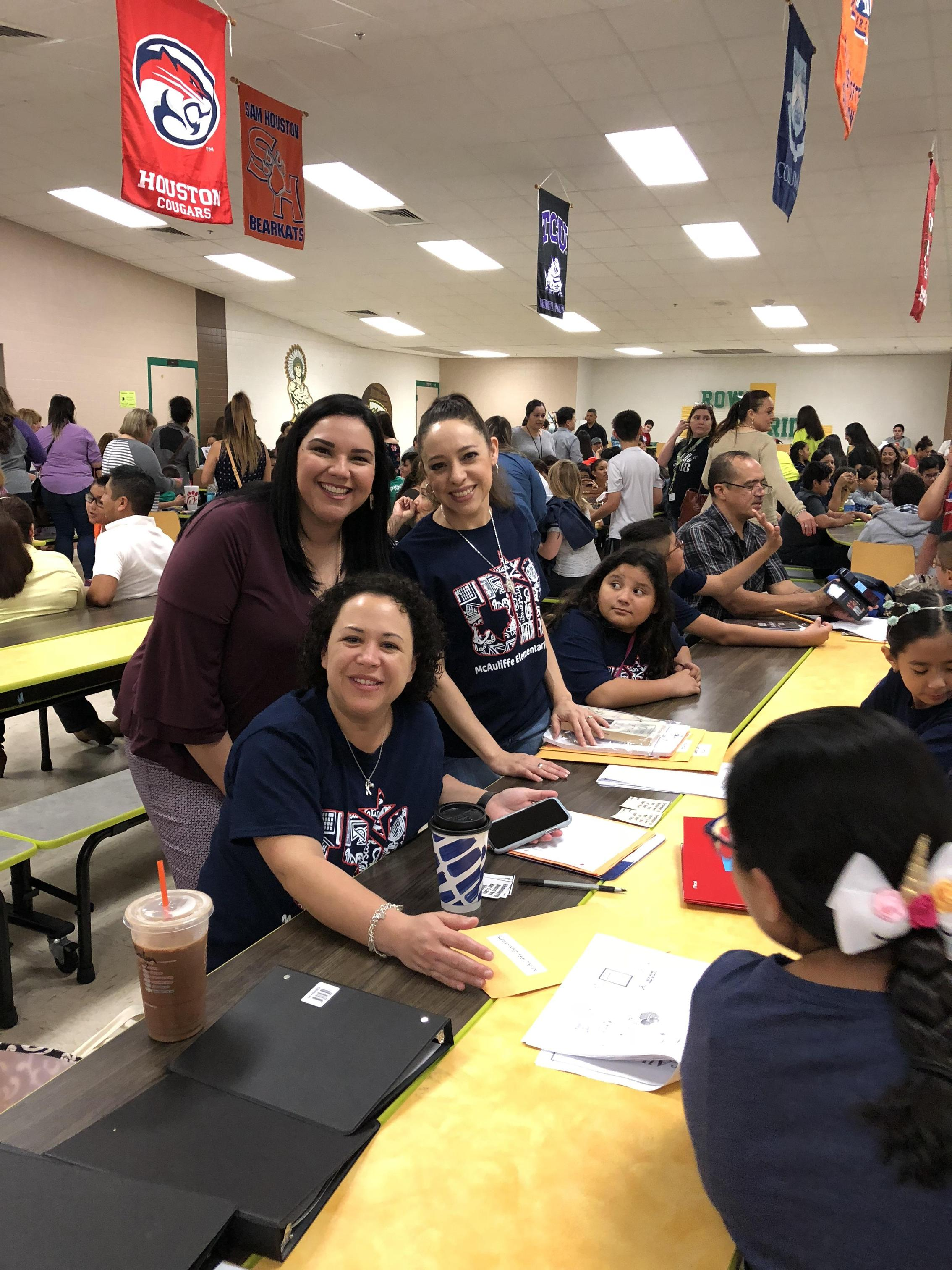 Mrs. Saenz with UIL students in cafeteria.