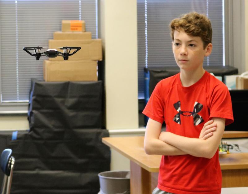 Edison 8th grader observes a drone aloft, after programming its flight pattern during a popular course at STEM Camp in Westfield.