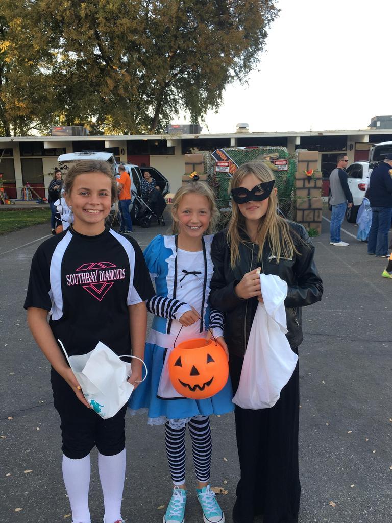 three girls in halloween costumes