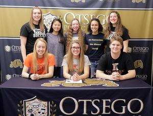 Alexis Petty with several teammates and boyfriend at her signing.