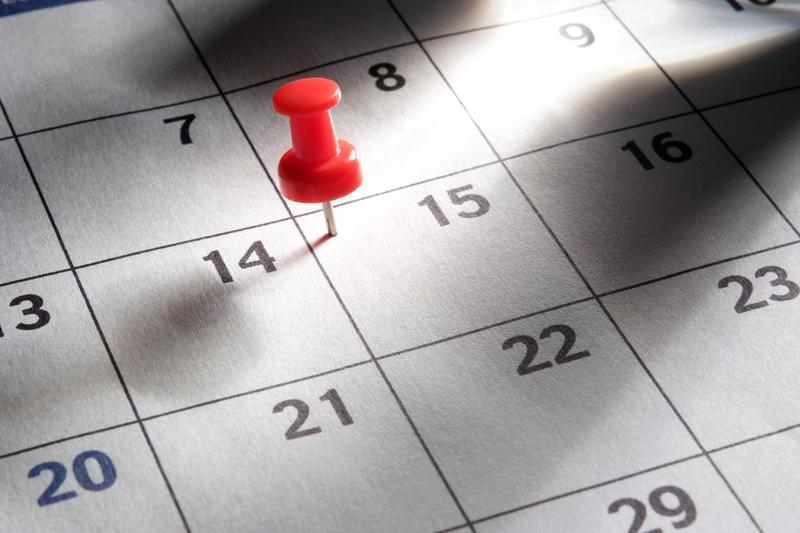 Calendar with pin on it